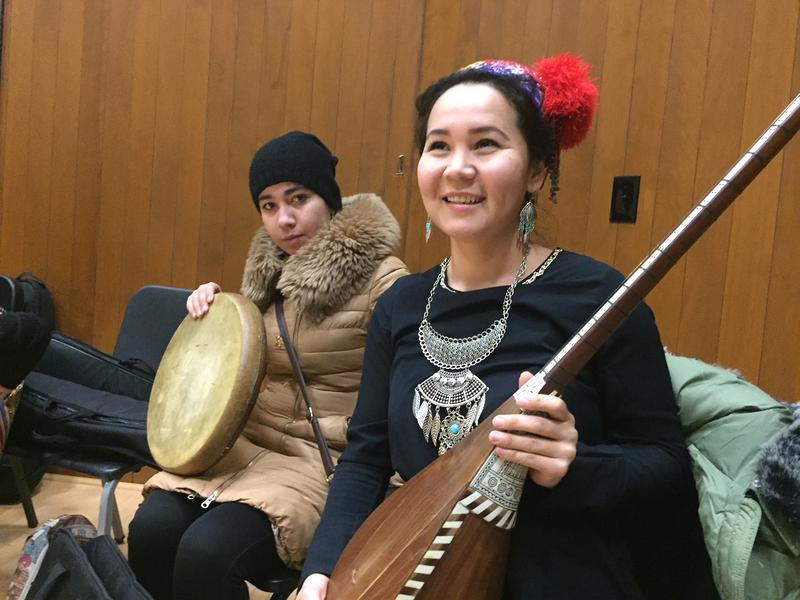 Gumshagul Bekturganova, right, holds her instrument, the dutar, during rehearsals at Dartmouth College. Aziza Davronova sits behind her.