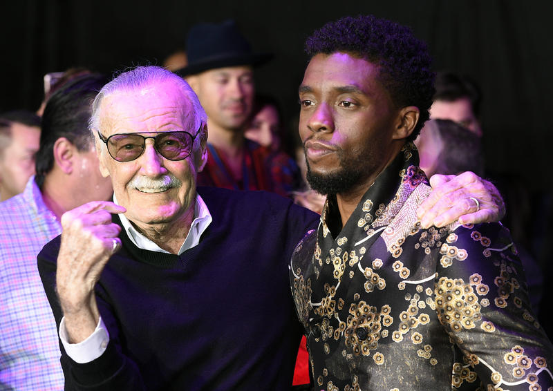 Comic book legend Stan Lee and actor Chadwick Boseman pose together at the LA premiere of