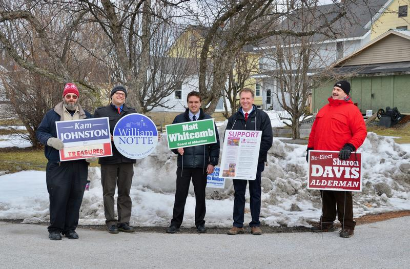 Several Rutland City board of aldermen candidates stand outside one of the city's polling places Tuesday.