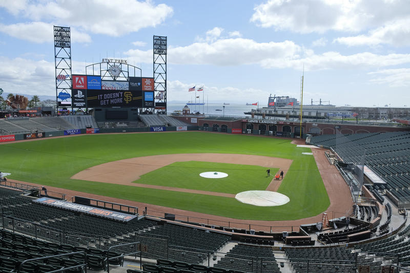 Groundskeepers work on the field at AT&T Park during the San Francisco Giants media open house. MLB opening day is Thursday.