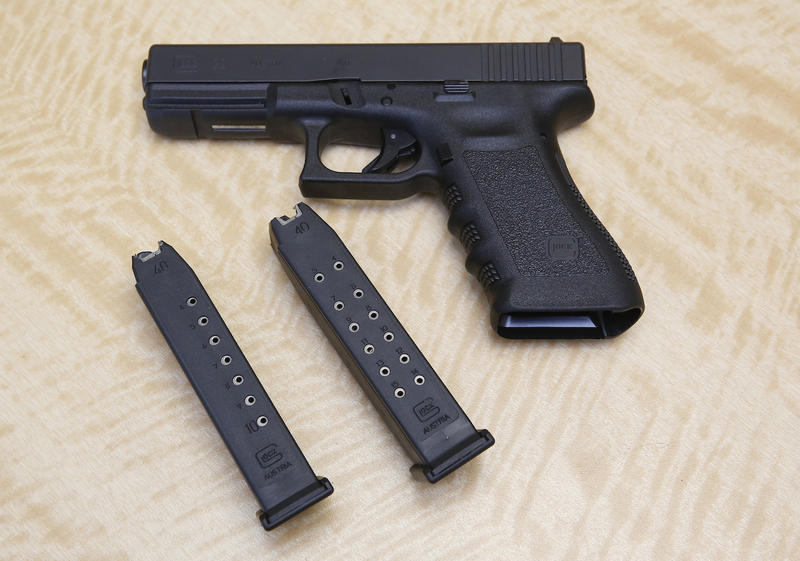 A 10-round, left, and 15-round magazine, center, and a semi-automatic handgun.