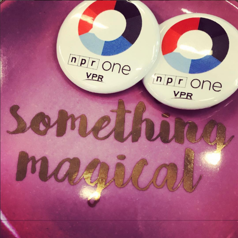Two NPR One pins with the VPR logo on a pink dish that says Something Magical.