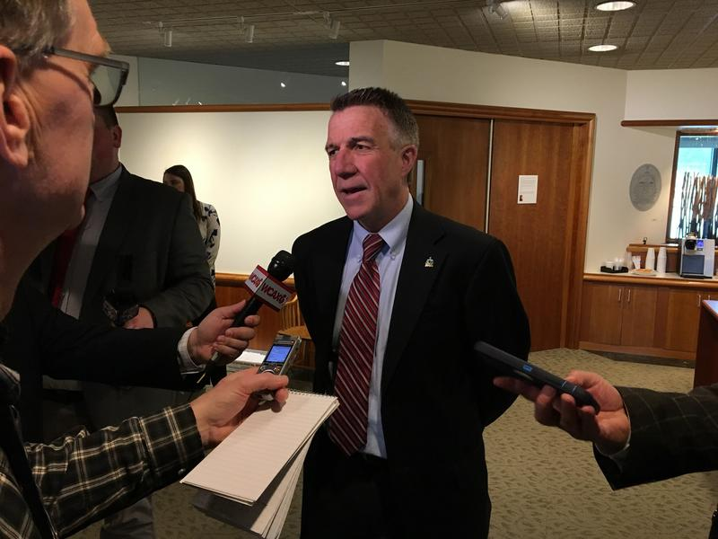 Gov. Phil Scott tells reporters that he