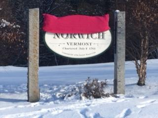 A hand-knit pink pussy hat adorns the Norwich welcome sign in recognition of the one-year anniversary of the Women's March.