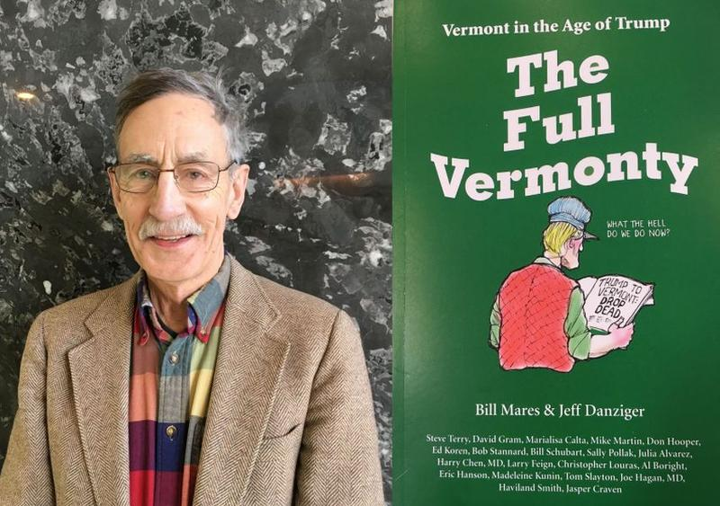 "Bill Mares stands in front of a wall with an image of the cover of the book ""The Full Vermonty."""