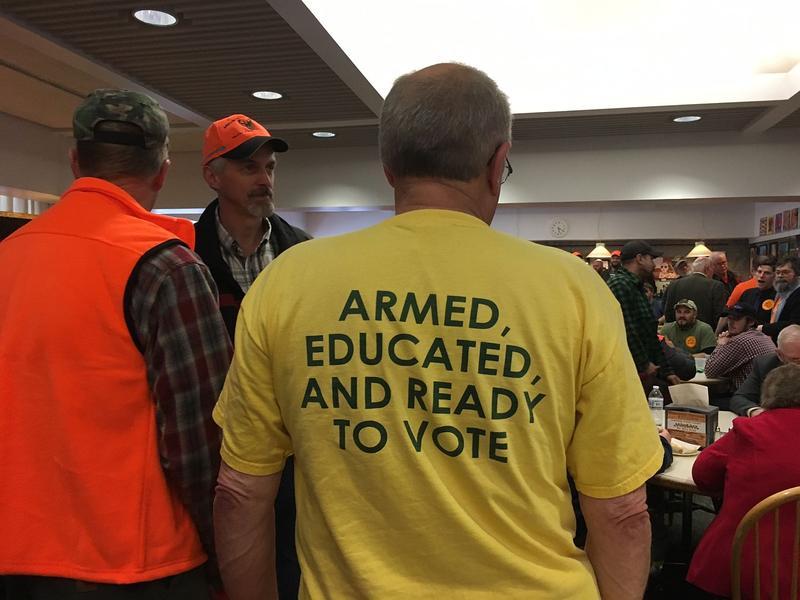 Ed Wilson, in yellow, was one of nearly 200 gun rights advocates in the Statehouse cafeteria Tuesday evening. Wilson and others say proposed gun legislation in Montpelier would infringe on gun owners' rights.
