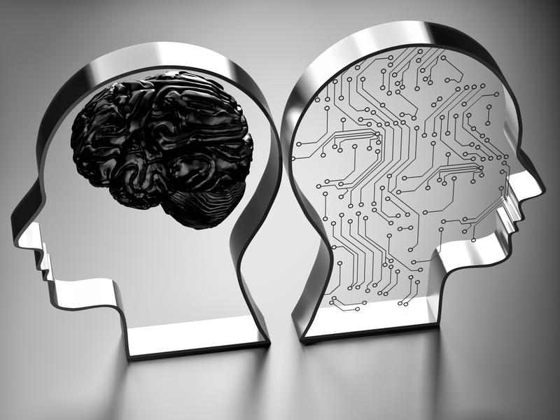 Two metallic silhouettes of heads, one with a brain inside and one with computer imagery.