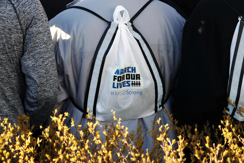 A Marjory Stoneman Douglas High School student wears a March For Our Lives backpack