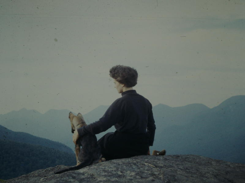 Ida Lange is pictured with the Langes' German shepherd, Hans, at the top of Three Brothers near Keene Valley, NY, in the summer of 1959.
