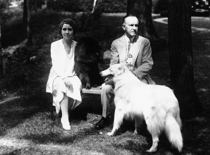 Calvin and Grace Coolidge relax with family pets, including Rob Roy on the right.