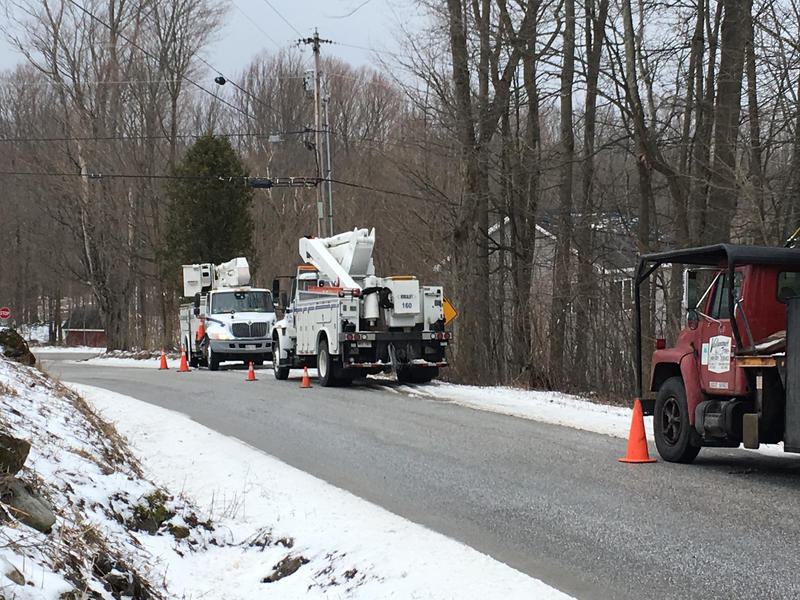 Crews from New Brunswick, Canada, fixing downed power lines in Chittenden, Vt.