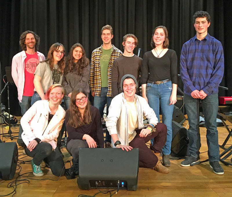 "SoundCheck members pose onstage at Peoples Academy. Back row (L-R): Brian Boyes, Elizabeth Autorino, Ruby Klarich, Liam Mears, Wilson Knight, Paige Thibault, Bruno John. Front row (L-R): Cameron Mueller-Harder, Grace Carlomango, Logan ""Loganic"" Wedge."