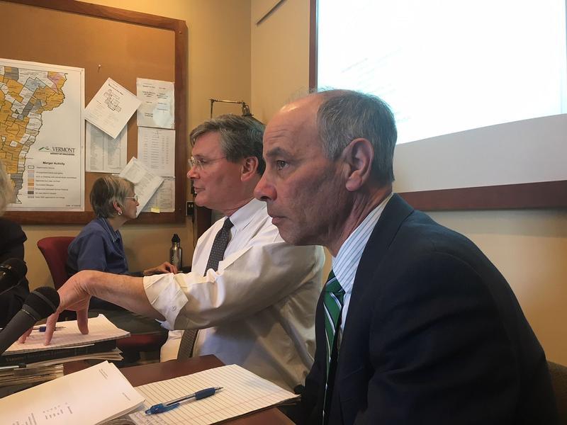 Commissioner of Finance Adam Greshin, right, and Brad James from the Agency of Education, second from right, brief lawmakers Monday on a plan that would try to reduce payroll costs in public schools by penalizing districts with higher staffing levels.