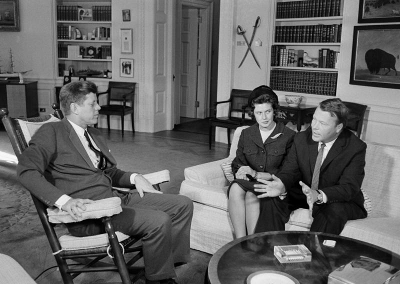 Then Governor-elect Philip Hoff sits on a couch with his wife Joan at the White House talking with President John F. Kennedy.