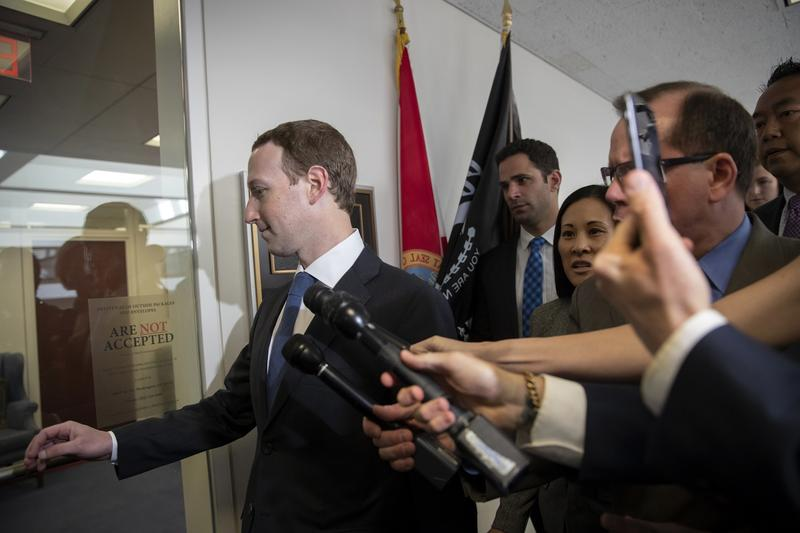 Mark Zuckerberg, the CEO of Facebook, arrives for a Capitol Hill Meeting with Sen. Bill Nelson on Monday. Later in the week, Zuckerberg will be testifying before members of Congress about how Facebook data was used in the 2016 election.""