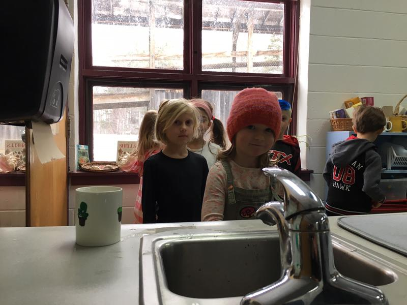 First and second grade students line up to wash their hands at Marlboro Elementary School.