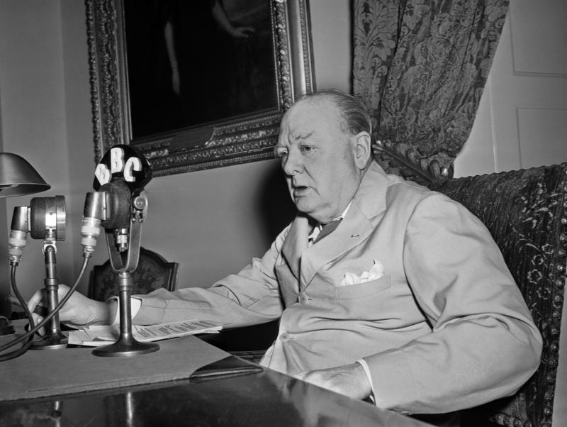 British Prime Minister Winston Churchill delivers an address via radio from Washington in this May 14, 1945 file photo.