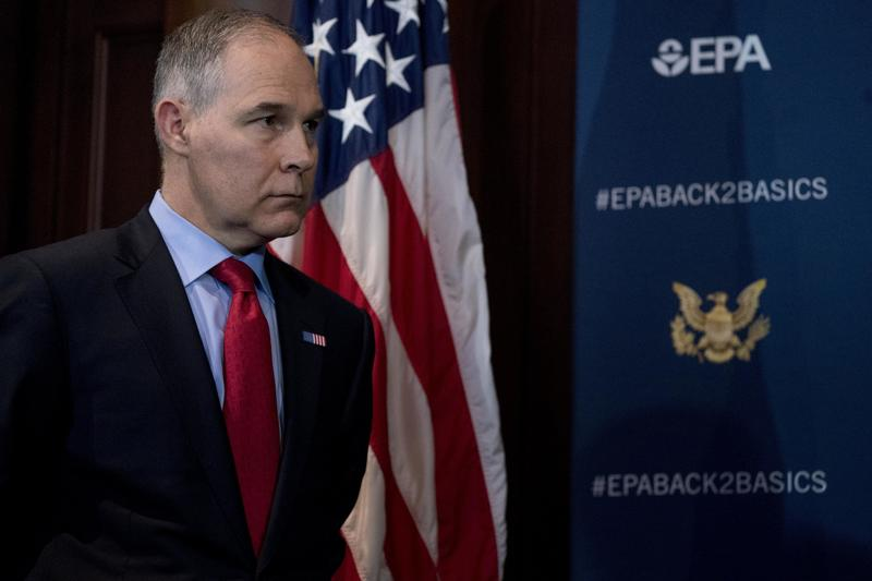 Scott Pruitt stands in front of an American flag and an EPA sign at a press conference in Washington, D.C. on April 3, 2018.