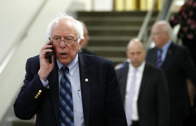 Sen. Bernie Sanders talks on his phone as he departs after a vote on Gina Haspel to be CIA director, on Capitol Hill, Thursday, May 17, 2018 in Washington.