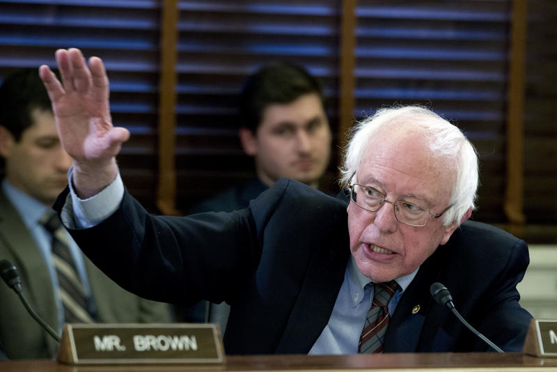 Sen. Bernie Sanders raises his hand during a Senate Committee on Veteran Affairs hearing