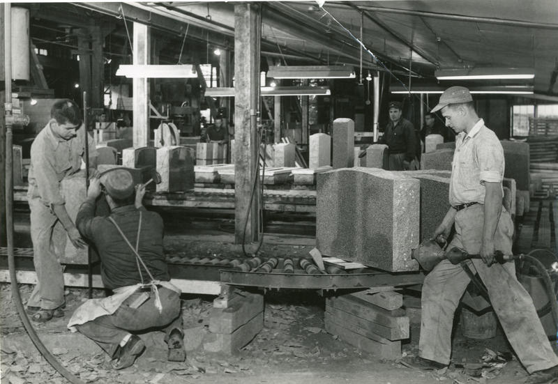 Men work in a granite processing facility.