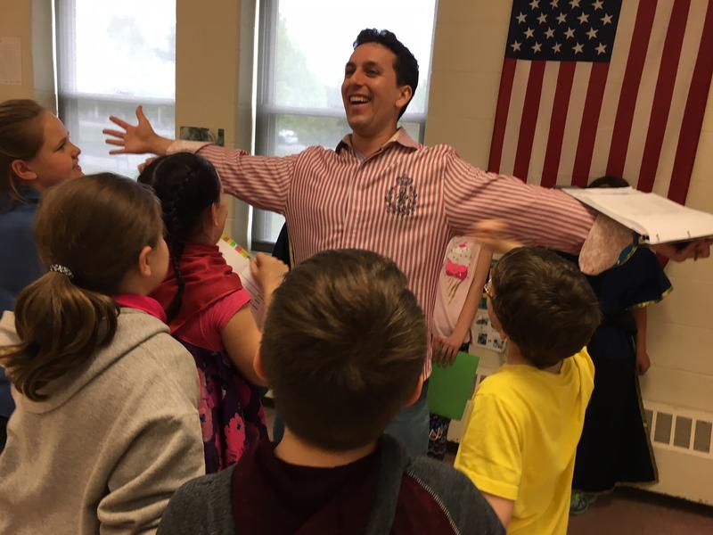 Northern Stage education director Eric Love works with students at Dothan Brook School in White River Junction.