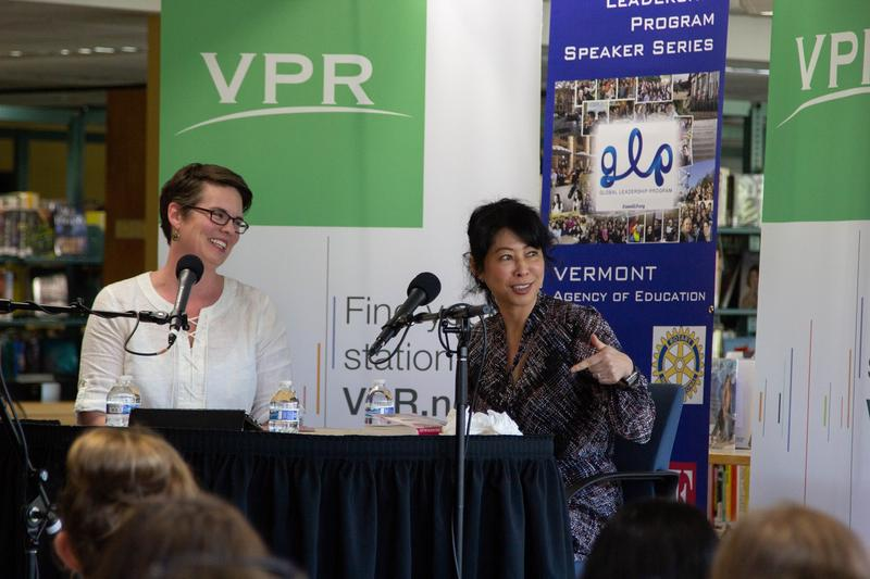"Author Loung Ung, right, talks with ""Vermont Edition"" host Jane Lindholm before the students in Essex High School's Global Leadership Program."