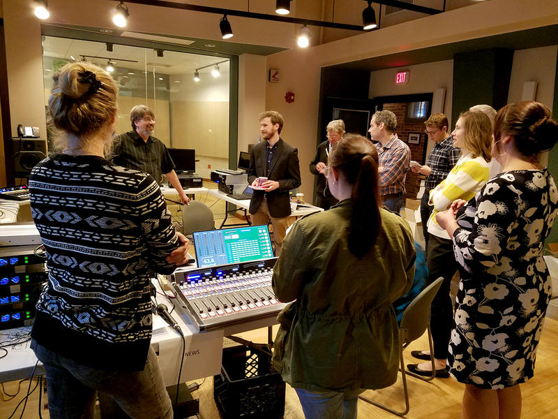 Broadcast studio engineer Frank Alwine (back left) conducts a training session on the new equipment on Tuesday May 15, 2018.