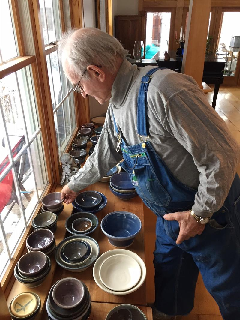 Yvan Plouffe shows off some of his pottery creations. He took up the craft 10 years ago at the age of 70.
