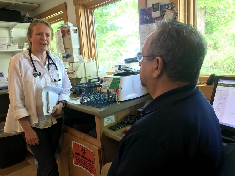 Dr. Hannah Rabin, left, talks with Danny Ciccariello, right, a phlebotomist, at Richmond Family Medicine.