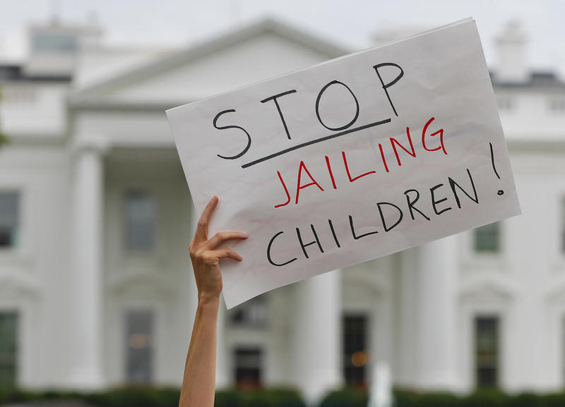 A protester outside the White House in Washington, D.C., Thursday. Members of the Vermont House voted Friday to oppose a decision by the Trump Administration to separate children from undocumented parents at the border.