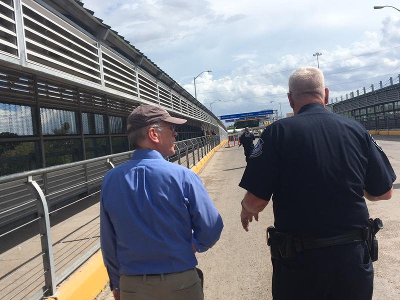 Rep. Peter Welch, left, talks with a border agent at the Hidalgo Port of Entry along the Mexico-U.S. border Sunday.