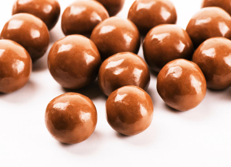 This is a stock photo of chocolate malt ball candy similar to the ones police say employee of the Inn at Shelburne Farms mistakenly ate Wednesday. Instead of being candy, the food left behind by a guest were edibles.