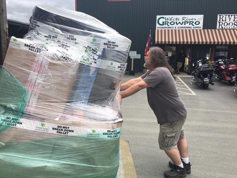 White River Growpro co-owner Kendall Smith gets ready to move a pallet of growing supplies into his store in White River Junction. Smith expects to see a big bump in business as more Vermonters grow their won cannabis.