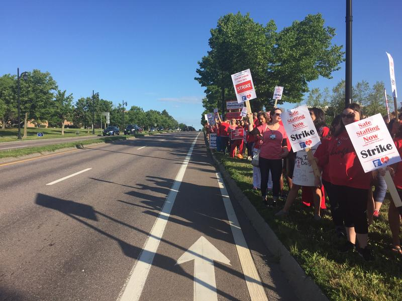 Nurses and supporters picketed outside of UVM Medical Center on Main Street in Burlington, Vt.