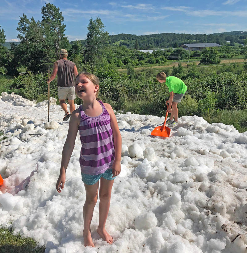 Eliza Nellis, 7, and her brother Parker, 11, got to spend an early July day playing in the snow in Craftsbury.