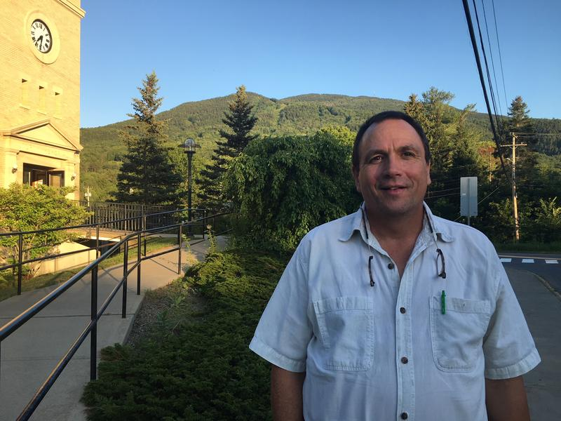 Rob Hutchins stands in front of the West Windsor municipal building with Mount Ascutney in the background.