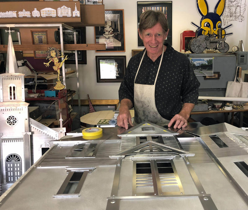 Artist Phil Godenschwager works in his Randolph studio on assembling a train car that represents the Waterbury Historical Society building, also known as Dr. Janes' house.