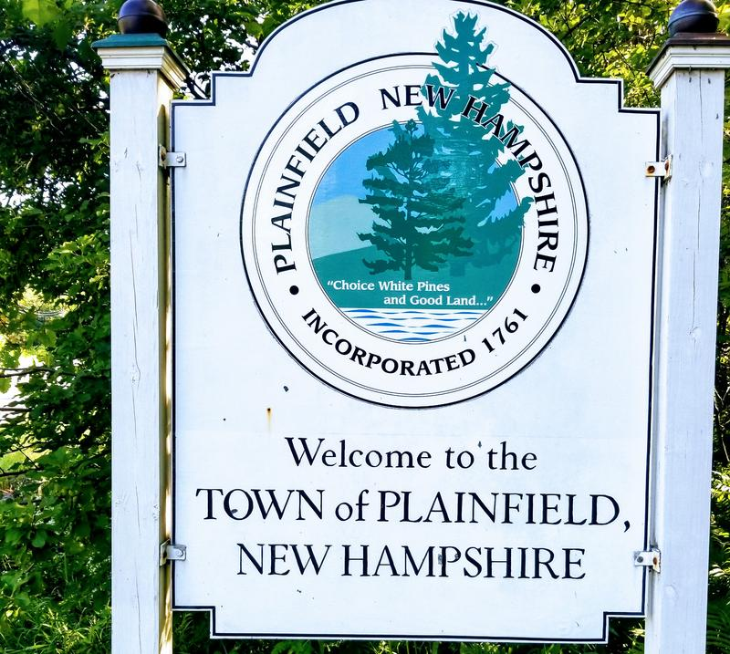 Traditional sign welcomes visitors to the town of Plainfield, NH.