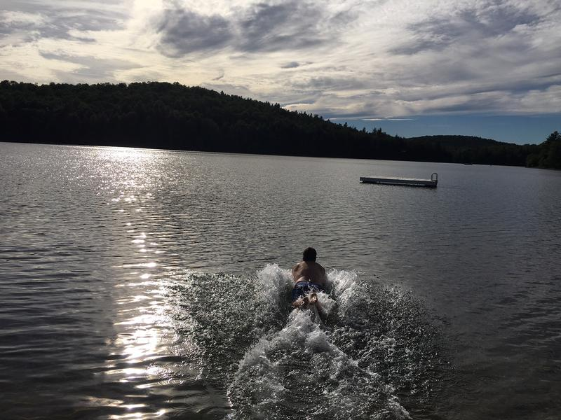 Marlboro resident Marco Panella dives into South Pond for his daily swim across the water.