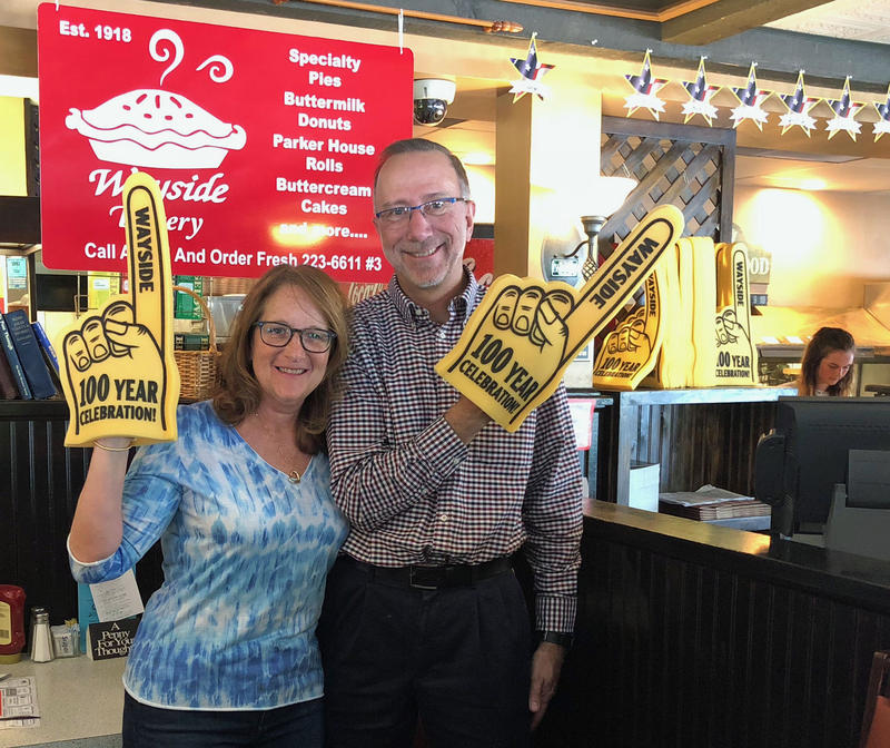 Wayside Restaurant owners Karen and Brian Zecchinelli show off some of their 100th anniversary swag. While they're celebrating all year long, a big ice cream social with fireworks is planned for July 29.