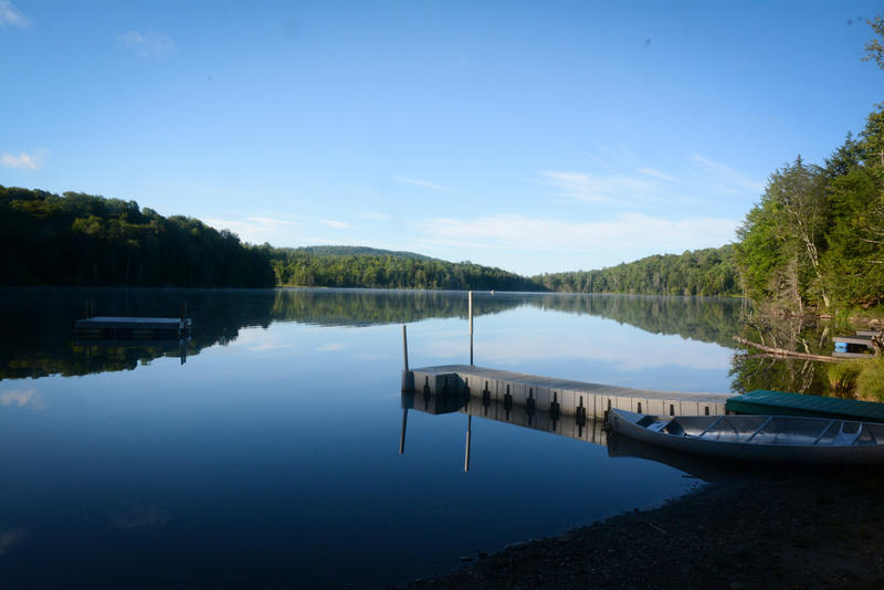 A shot of Buck Lake in Woodbury Vermont on a blue sky day.