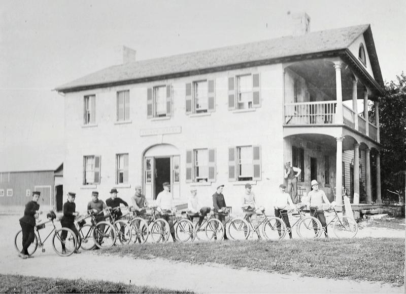 Cyclists outside the Island House in South Hero.