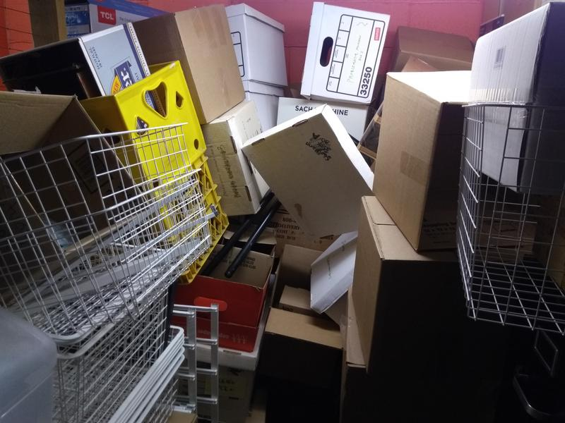 Packing boxes wait for the next move.