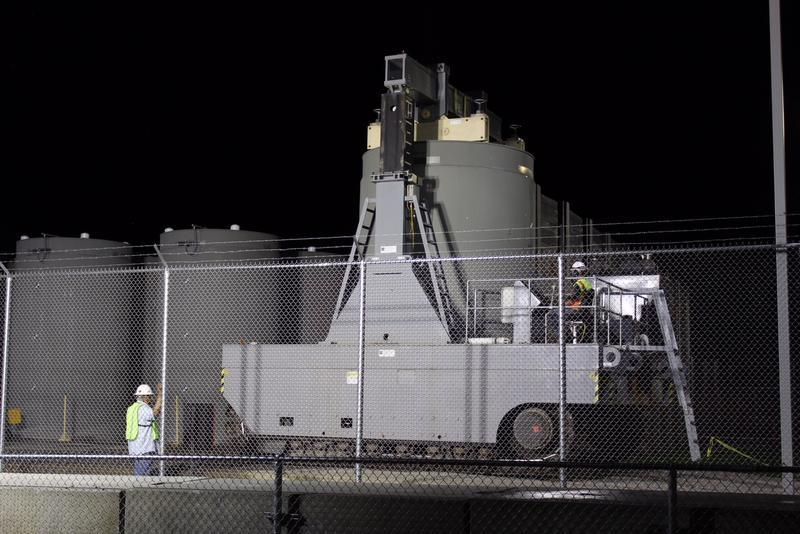 Vermont Yankee employees move the last of the plant's spent nuclear fuel into storage casks.