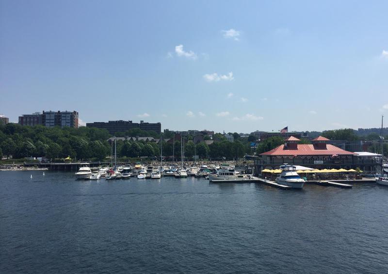 Burlington Community Boathouse Marina view from the lake on a blue-sky day.