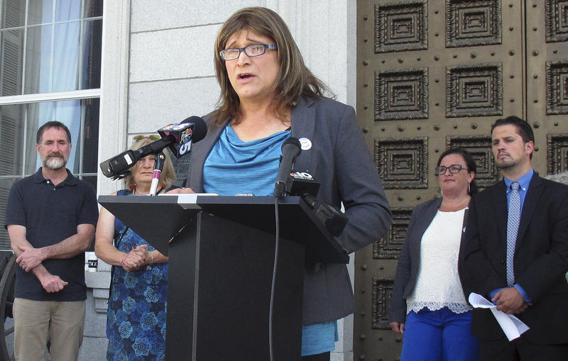 Democratic gubernatorial nominee Christine Hallquist speaks at a podium in Montpelier during a news conference.