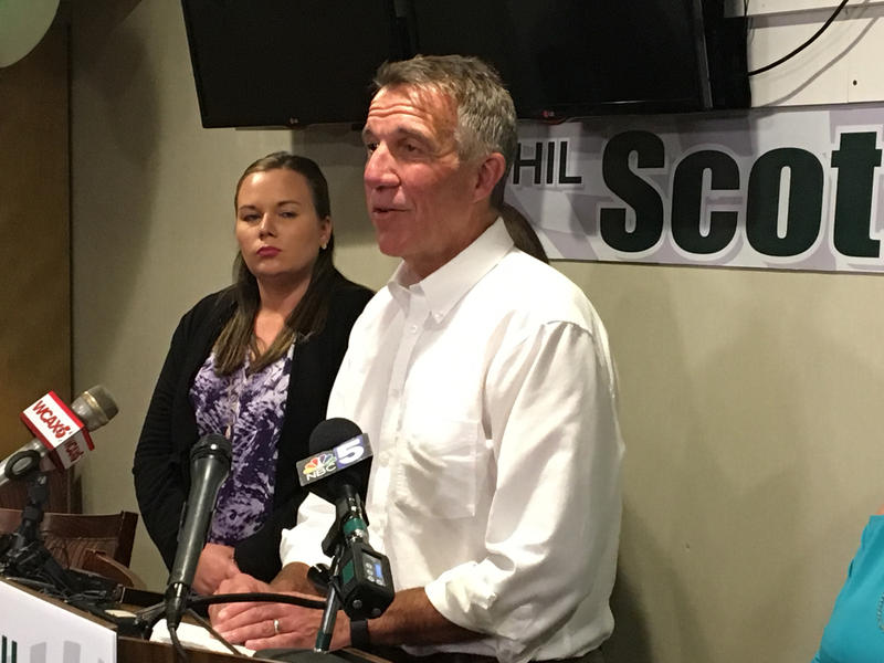 Gov. Phil Scott speaks at a podium following The Associated Press calling him the winner of the Republican gubernatorial primary race.