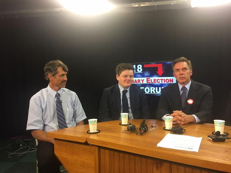 Ethan Sonneborn, center, prepares for a gubernatorial debate against fellow candidates including John Rodgers, left, and James Ehlers, right. Sonneborn says he thinks his youth is an asset in the race for governor, not a liability.