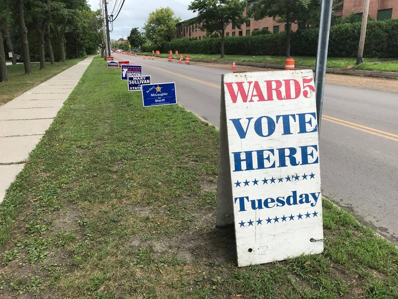 A sign lets Burlington's Ward 5 voters know where to vote, as various candidate signs line up behind it.